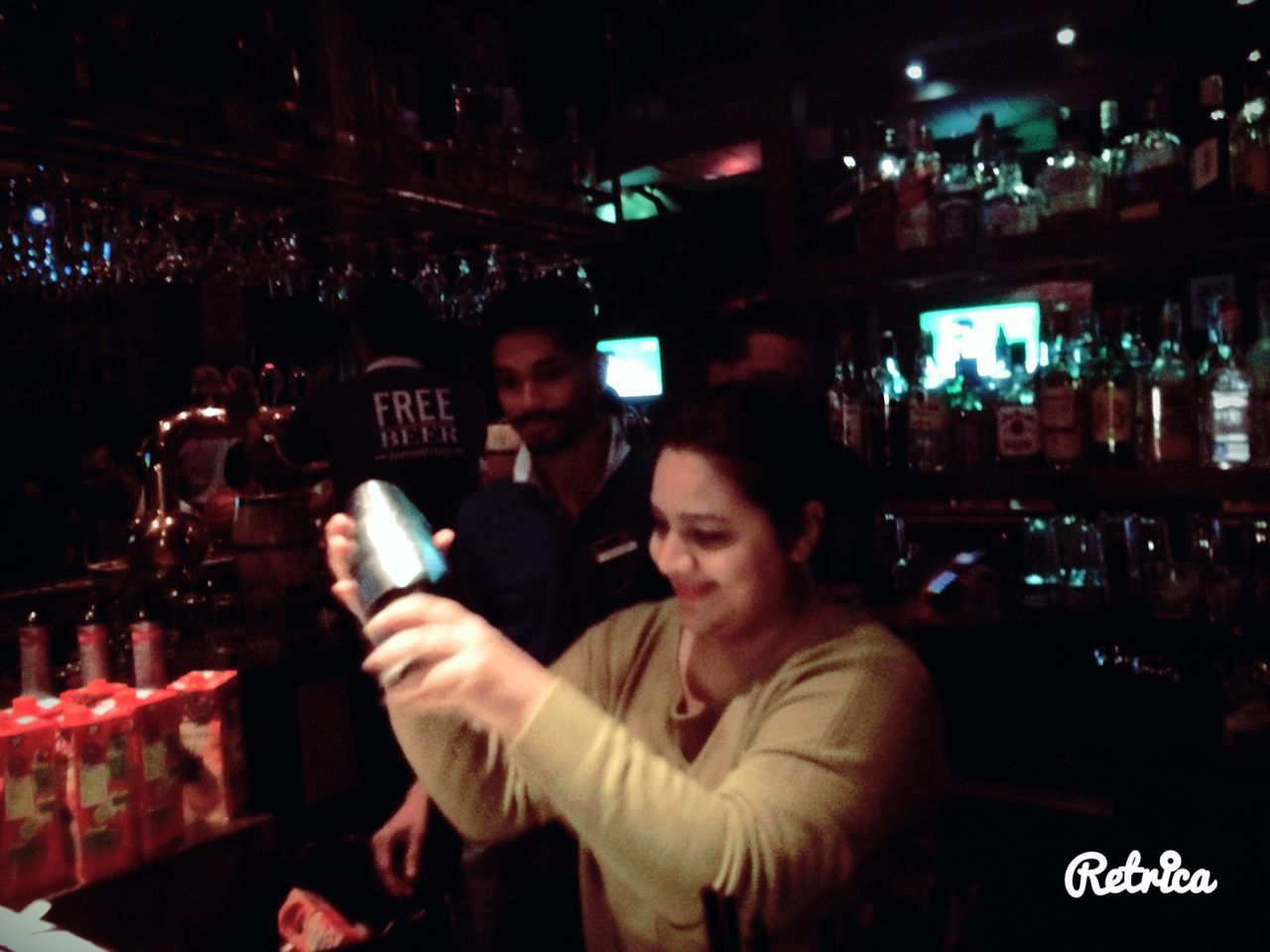 night, alcohol, nightlife, bottle, illuminated, bar counter, two people, bar - drink establishment, drink, nightclub, men, togetherness, indoors, bartender, happiness, happy hour, friendship, smiling, real people, city, young adult, people