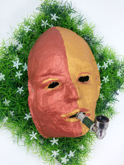 Abhängigkeit Bizarre Art Car Aggressive Behavior Close-up Crack-pipe Dependence Drug Dependent Drug-addicted Drugpipe Fear Grass Green Color Hopelessness Kiffen Marijuana Mask - Disguise Mask_collection Maske  No People Psychedelic Psychological Psychological Therapy Red Sucht Whistle