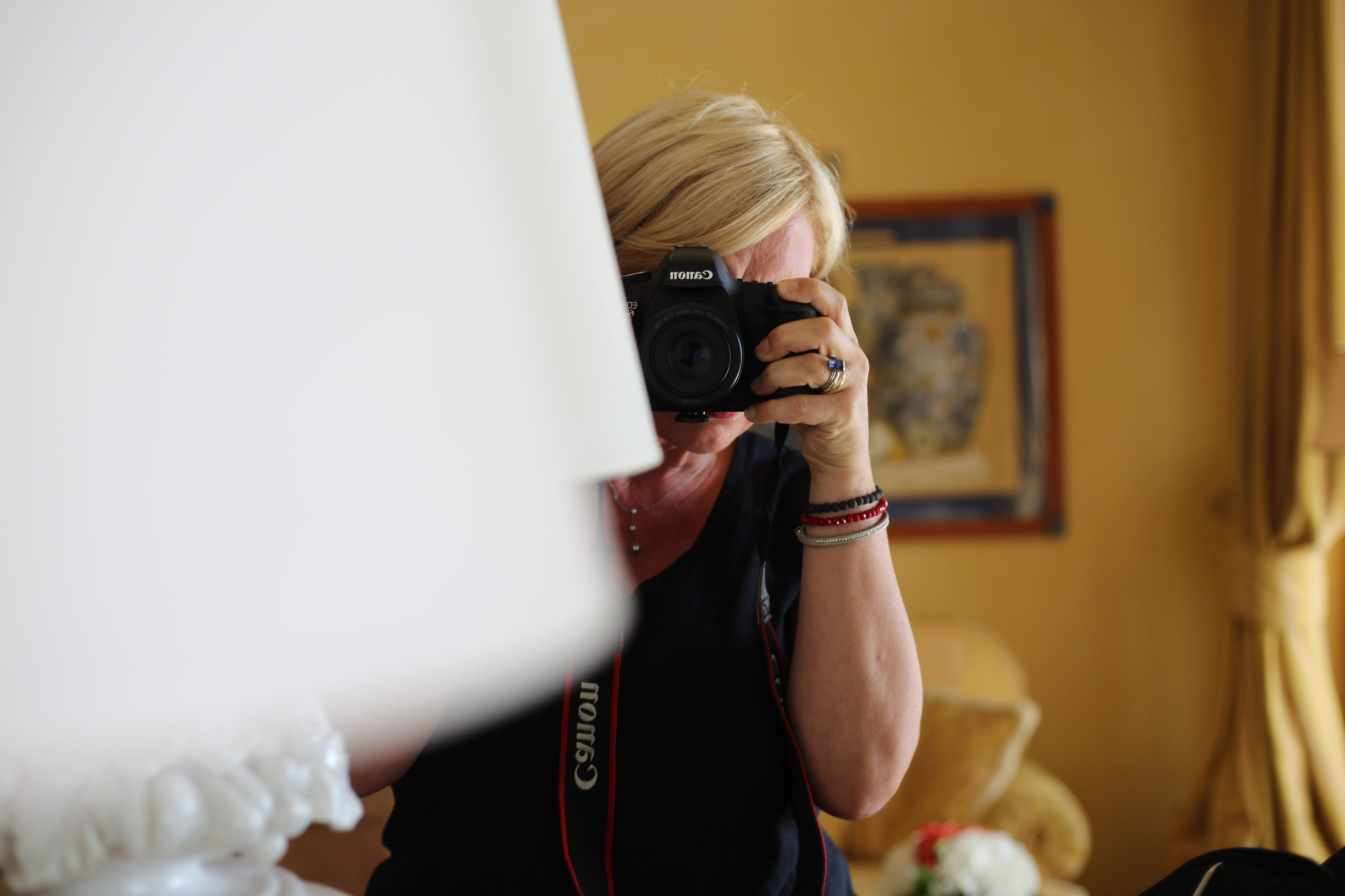photographing, photography themes, real people, camera - photographic equipment, holding, one person, photographer, technology, indoors, blond hair, digital single-lens reflex camera, day, close-up, young adult, people