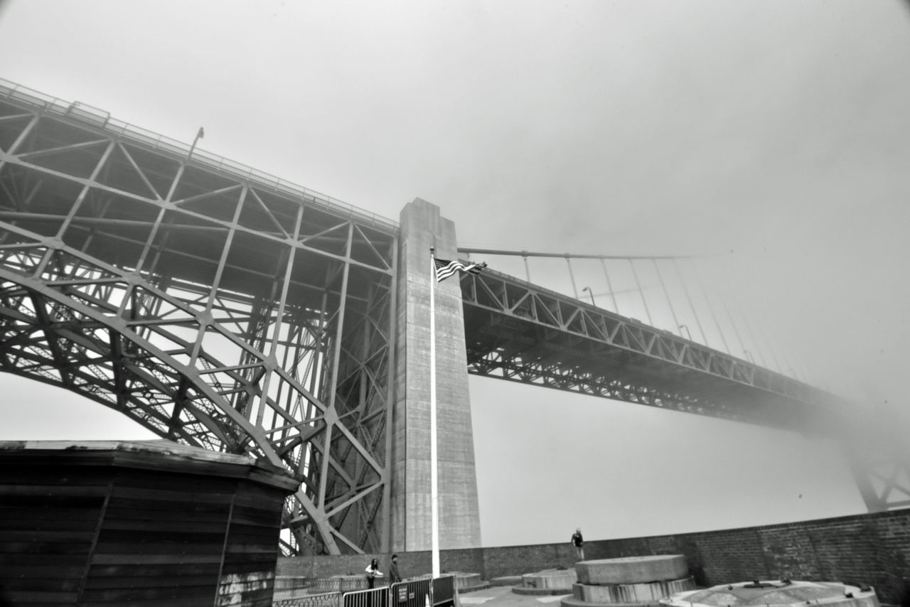 Golden Gate Bridge @ Fort Point 1 San Francisco Bay Fort Point 1861 Golden Gate Bridge 1937Fog Socked In Bnw_friday_eyeemchallenge Vanishing Point Reduced Visibility Foggy Day Bridge Span Bridge Arch Bridge Tower Dimenishing Perspective U.S.Flag Artillery Batteries People Looking Out Black & White Black And White Photography Black And White Black And White Collection  Monochrome Architecture Architectural Detail