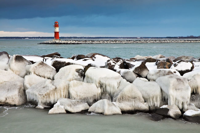 Mole in Warnemuende, Germany. Architecture Beauty In Nature Built Structure Calm Day Lighthouse Lighthouse Mole Nature No People Non-urban Scene Ocean Protection Rocky Coastline Rostock Safety Scenics Sea Shore Tranquil Scene Tranquility Warnemünde Water Waterfront Winter