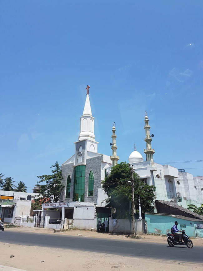 Architecture Blue Building Exterior Built Structure Christian Church City Communal Communication Day Façade Interfaith Interfaithrelationship Land Vehicle Low Angle View Mode Of Transport Mosque Muslim No People Outdoors Religion Sky Sunlight Tourism Travel Destinations