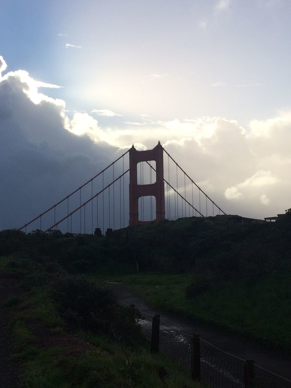 connection, bridge - man made structure, suspension bridge, architecture, sky, built structure, bridge, transportation, travel destinations, cloud - sky, tourism, outdoors, travel, no people, mountain, day