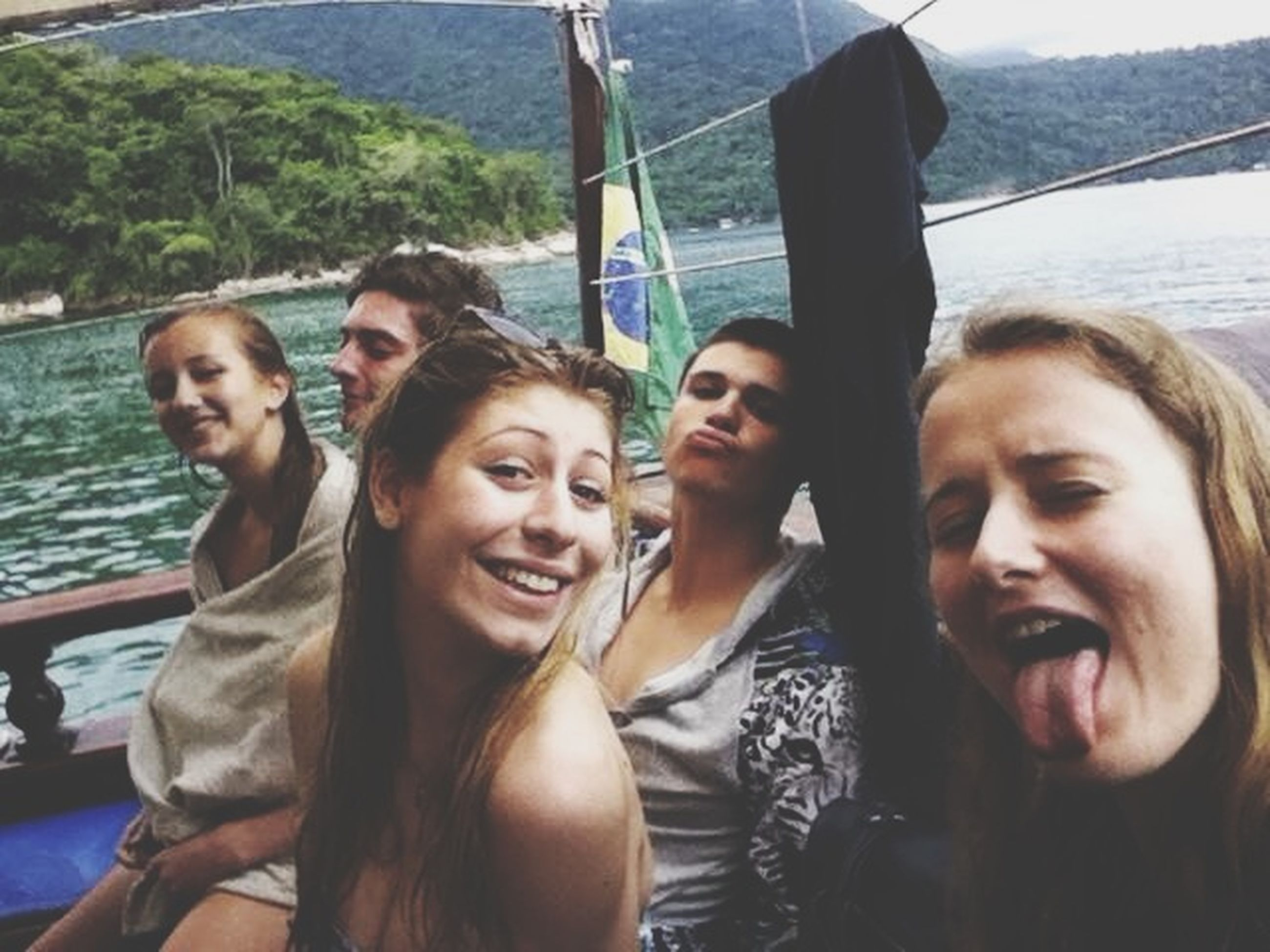 lifestyles, leisure activity, togetherness, water, person, bonding, happiness, love, smiling, young adult, young women, looking at camera, friendship, portrait, enjoyment, vacations, casual clothing, toothy smile