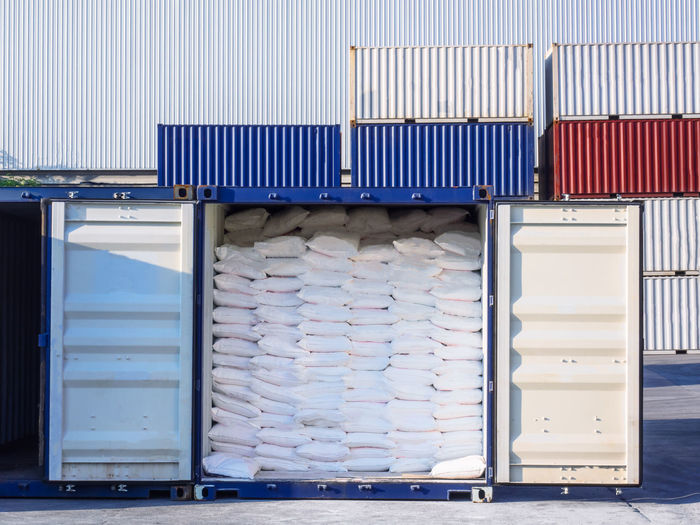 Sugar in bags to stuffing i n container at port of Thailand Stuffing Lifting Cargo Container Manufacturing Equipment Storage Overhead Crane Sugar Food Heaps Export Import Factory Starch Rice Trade Safety Closing Time Container Lift Indoors  Clean Shipping  Season  Stacking Logistics