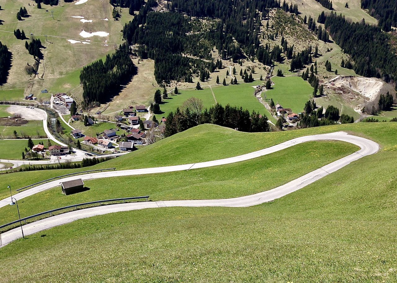 winding road in the alps, tannheimer tal, tirol Agriculture Alps Architecture Beauty In Nature Color Drone  Grass Greenery Landscape Light Mountain Nature Outdoor Outdoors Road Scenics Spring Tannheimer Tal Tirol  Travel Tree View From Above Village Winding Road Zugspitzblick