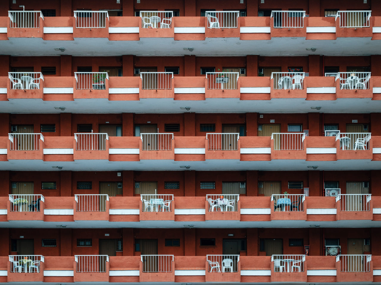 Texture of multistorey apartment house wall with balconies and windows in Puerto de la Cruz, Tenerife, Canary, Spain Apartment Buildings Geometric Shapes apartments Architecture backgrounds balcony building exterior built structure full frame geology hotel no people outdoors window window box