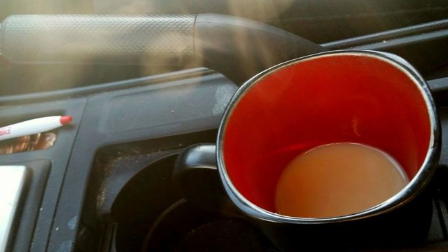 I live on the edge. Coffee On The Road On The Run Steam Hot Coffee No Lid Living Dangerously Breakfast In The Car Cellphone Photography In A Rush Hurry Coffee Mug Beverage Drink Morning Hot Drink Cupholder Cup Holder Stoneware Liquid Lunch