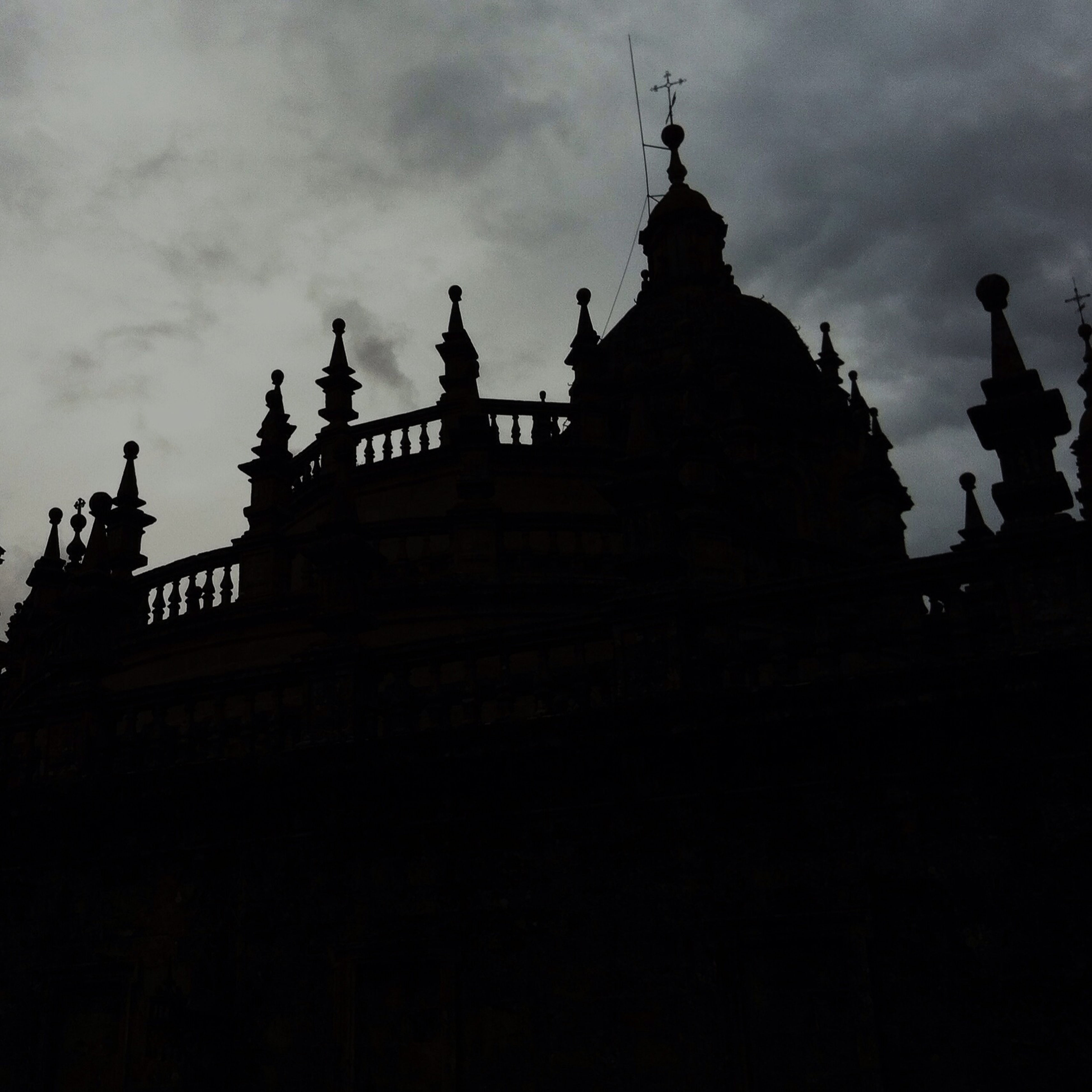 place of worship, religion, architecture, spirituality, built structure, building exterior, sky, low angle view, church, silhouette, temple - building, cloud - sky, dusk, cross, sunset, famous place, history, cathedral