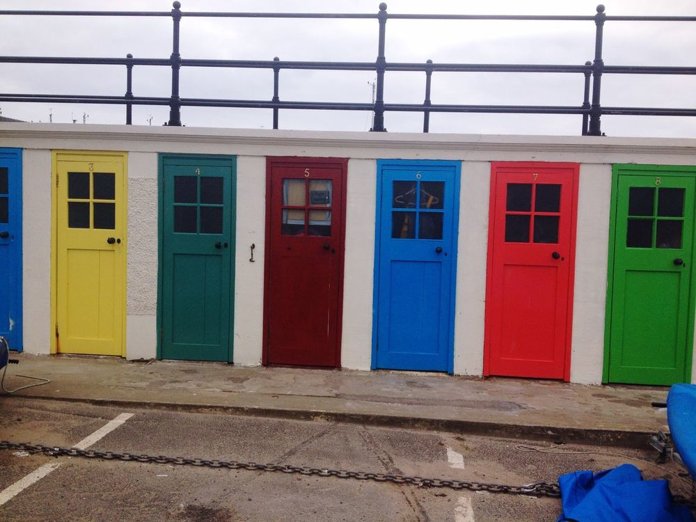 Love the colours of these little beach doors that used to be changing rooms for when you went swimming! Colors Colorful Doors Seaside Beach Colour Of Life