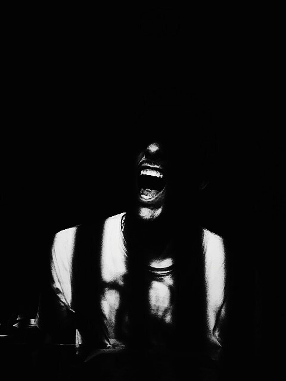 shadow, one person, smiling, indoors, dark, happiness, front view, real people, leisure activity, young adult, lifestyles, cheerful, portrait, night, young women, halloween, black background, adult, one man only, adults only, people