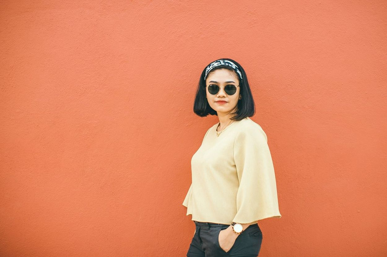 EyeEmNewHere wall Wall - Building Feature One Person Only Women Standing Colored Background One Woman Only Portrait Young Adult Orange Background Fashion Looking At Camera Adults Only One Young Woman Only Adult Lifestyles Young Women Human Body Part People Women Day EyeEmNewHere