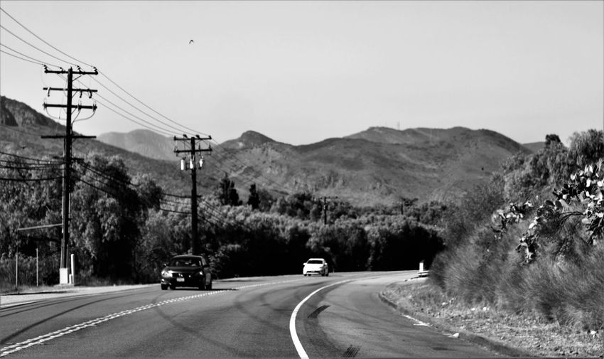 Black And White Blackandwhite Cable Car Cars Day Electricity  Electricity Pylon Greyscale Landscape Monochrome Moorpark Mountain Mountain Range Nature No People Outdoors Power Line  Road Road Sky The Way Forward Transportation Tree Vintage