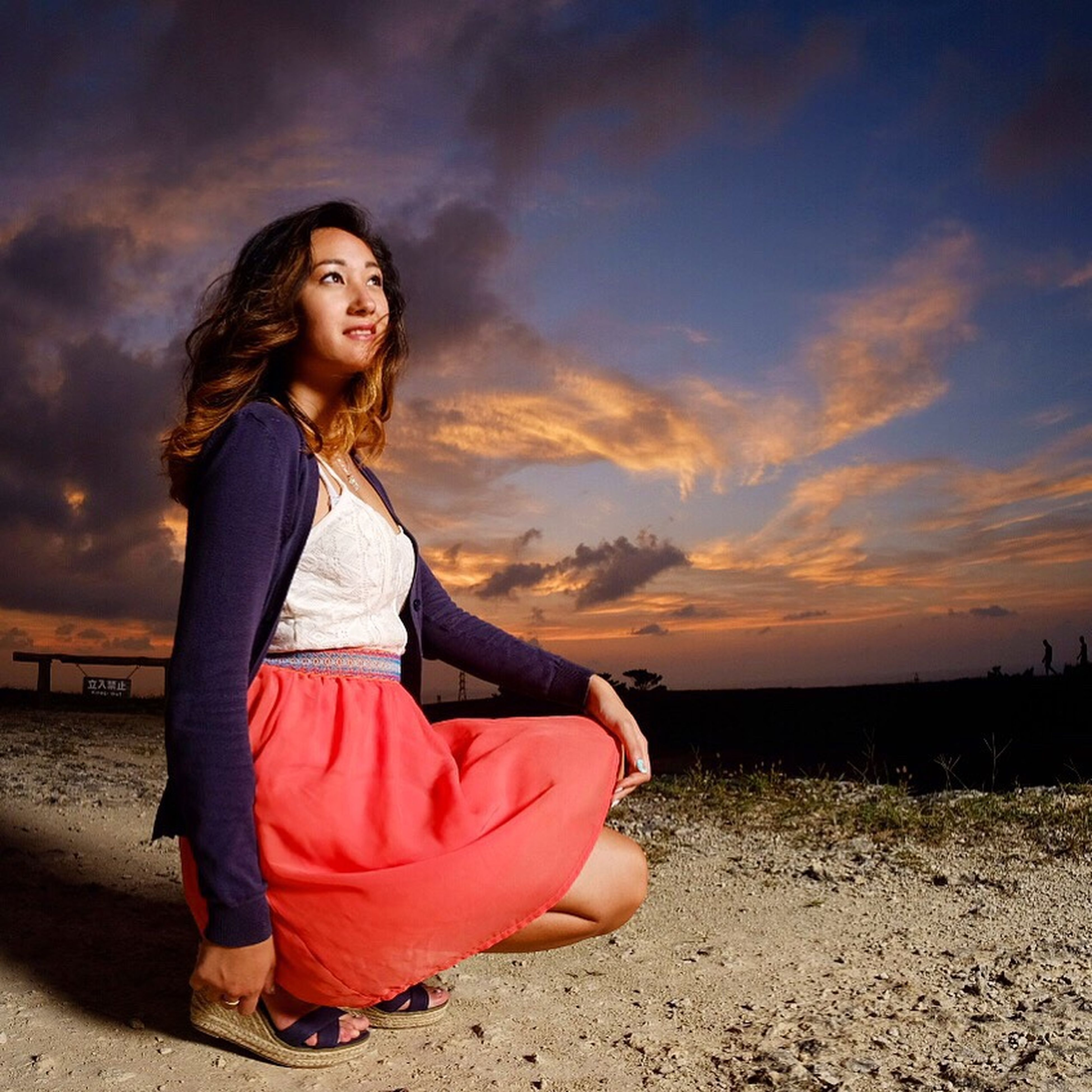 full length, casual clothing, young adult, young women, person, sunset, leisure activity, sky, long hair, cloud, field, vacations, contemplation, mixed race person, posing