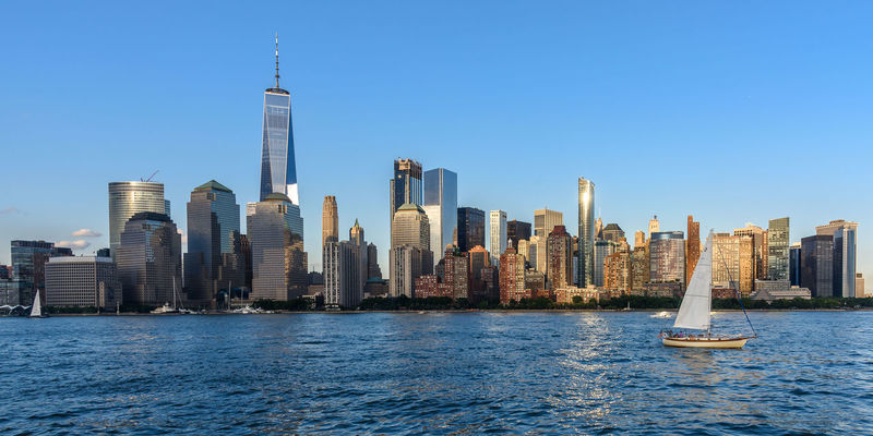 Manhattan New York City USA Architecture Blue Building Exterior Built Structure City Cityscape Clear Sky Downtown District Growth Modern No People Office Park Outdoors Sea Sky Skyscraper Tall - High Tower Travel Destinations Urban Skyline Water Waterfront