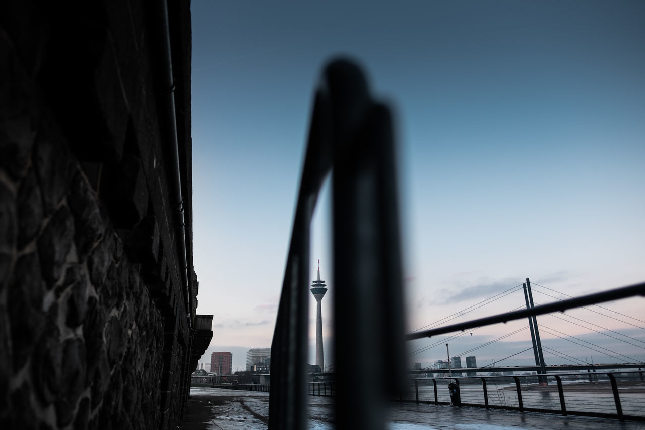 Ever put a tower through the eye of a needle? Architecture Photography Blue Hour Blue Sky City Photography Cold Day Deutschland Düsseldorf Early Morning Exploring Fujifilm Germany Morning Outdoors Rheinturm  River Riverside Sky Street Photography Sunrise Sunset Television Tower Wall Wide Angle X-T10
