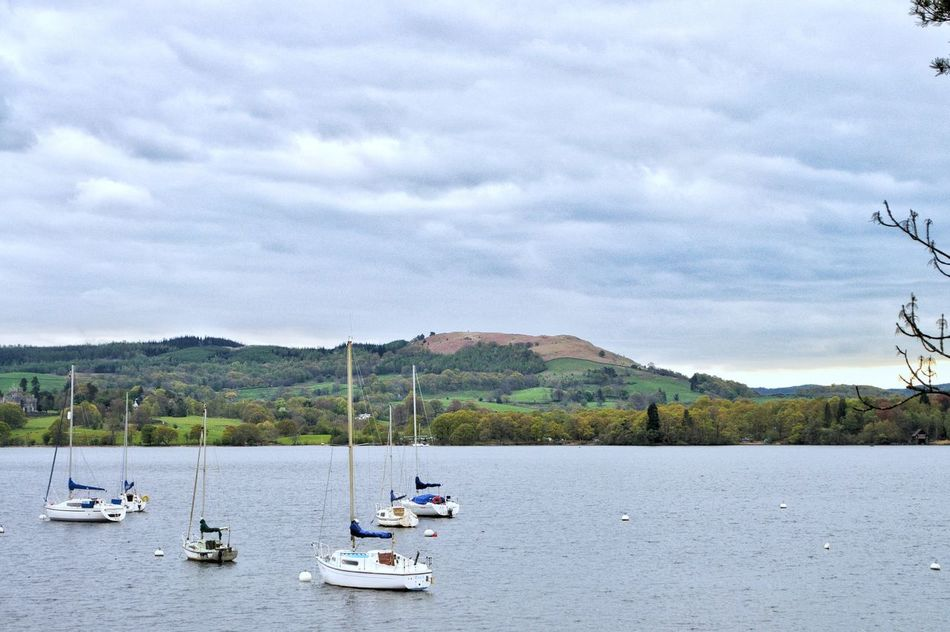 When the weather is moist and cold and the sun gives you a bliss by its warm raysWater Cloud - Sky Nautical Vessel Transportation Tree Mountain Day Outdoors Sky Nature Sailboat No People Beauty In Nature Lakedistrict Cityoflakes