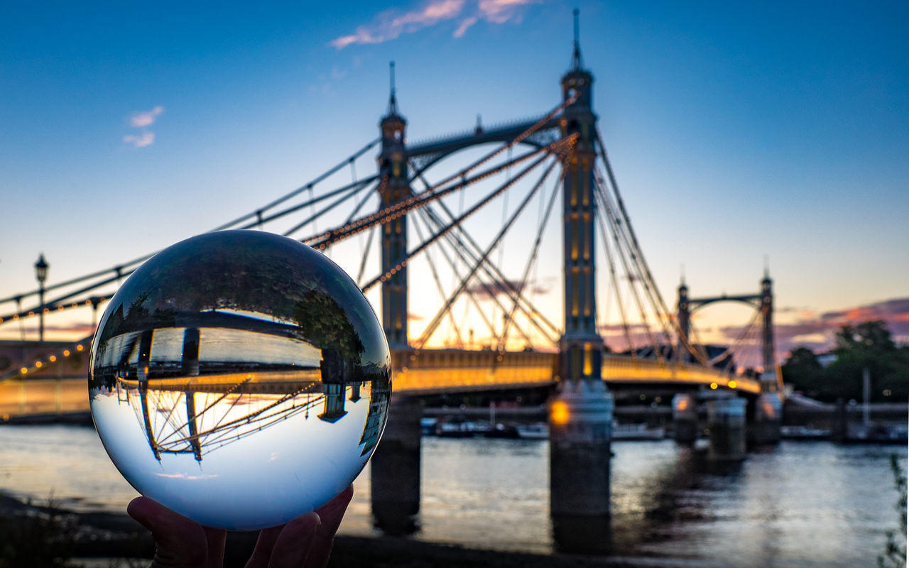 My favourite bridge over the Thames, seen through a crystal ball. Albert Bridge Architecture Battersea Bridge Britain Building Exterior Built Structure Capital City Cityscape Close-up Copy Space Crystal Ball England Famous Place London No People Outdoors Reflection Sky Sunset Tourism Travel Destinations United Kingdom Water