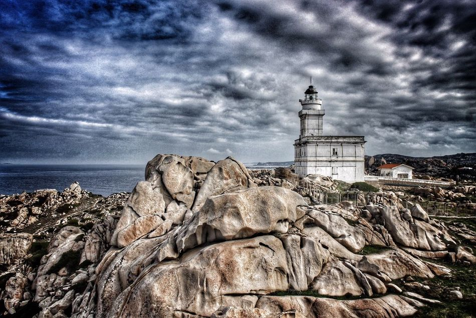 Showcase March Capotesta Sardegna Sardinia Italy Clouds And Sky Skyline Sea And Sky Building Landscape Island Emeye Travel Moments Lighthouse Italia Sky Weather Sea Colors Blue Rocks Darkness And Light Dark Architecture