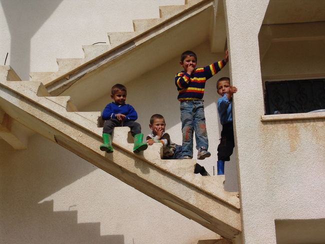 Architecture Boys Building Exterior Built Structure Child Childhood Day Elementary Age Front View Full Length Girls Leisure Activity Lifestyles Looking At Camera Low Angle View Mature Men Portrait Real People Smiling Son Staircase Standing Steps Steps And Staircases The Week On EyeEm