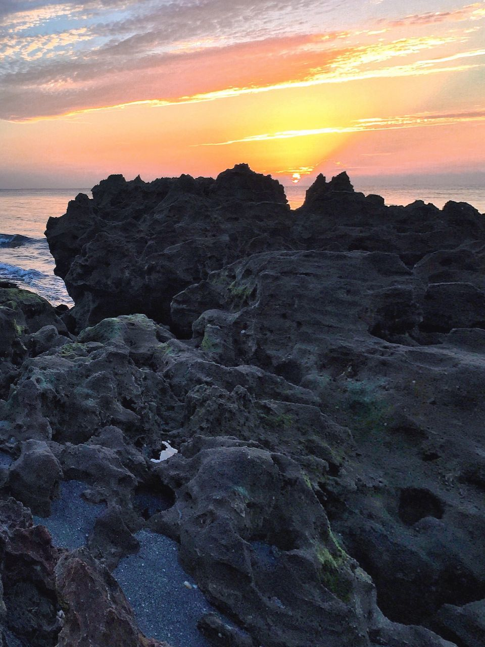 sunset, beauty in nature, nature, rock formation, rock - object, scenics, sky, orange color, tranquility, tranquil scene, idyllic, sea, outdoors, no people, sun, water, horizon over water, day