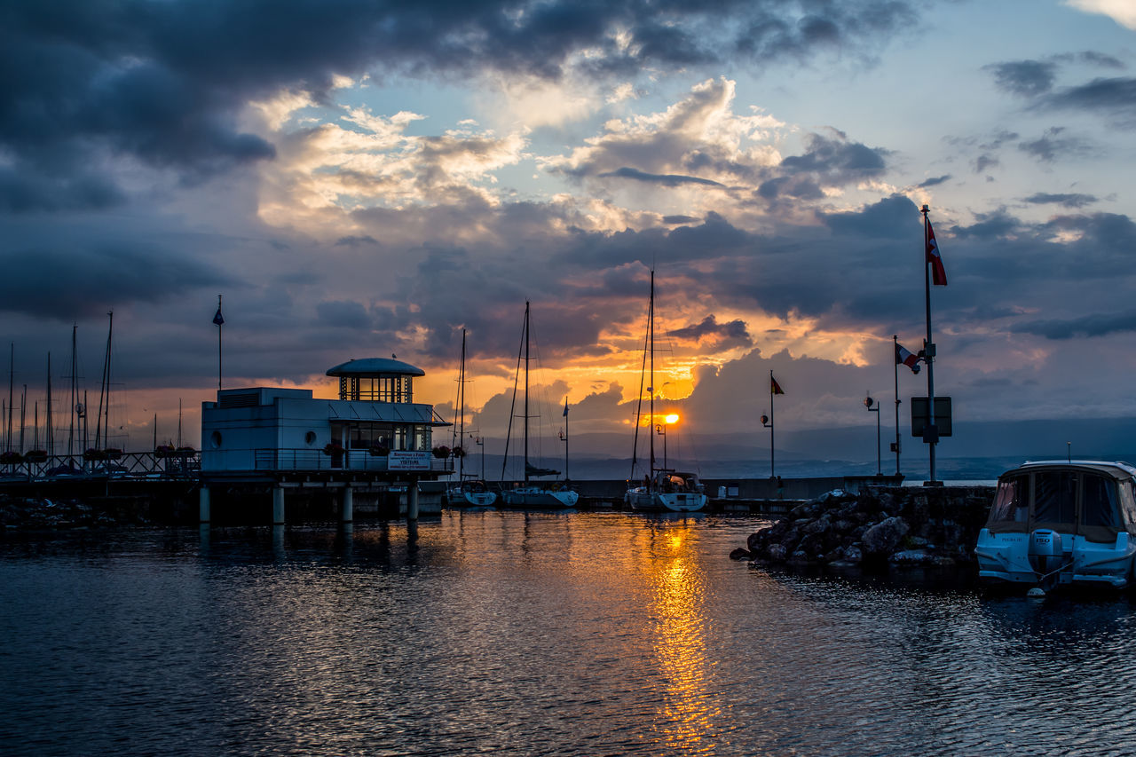 cloud - sky, sky, sunset, transportation, mode of transport, nautical vessel, water, nature, no people, sea, outdoors, waterfront, built structure, harbor, moored, travel destinations, architecture, mast, beauty in nature, day