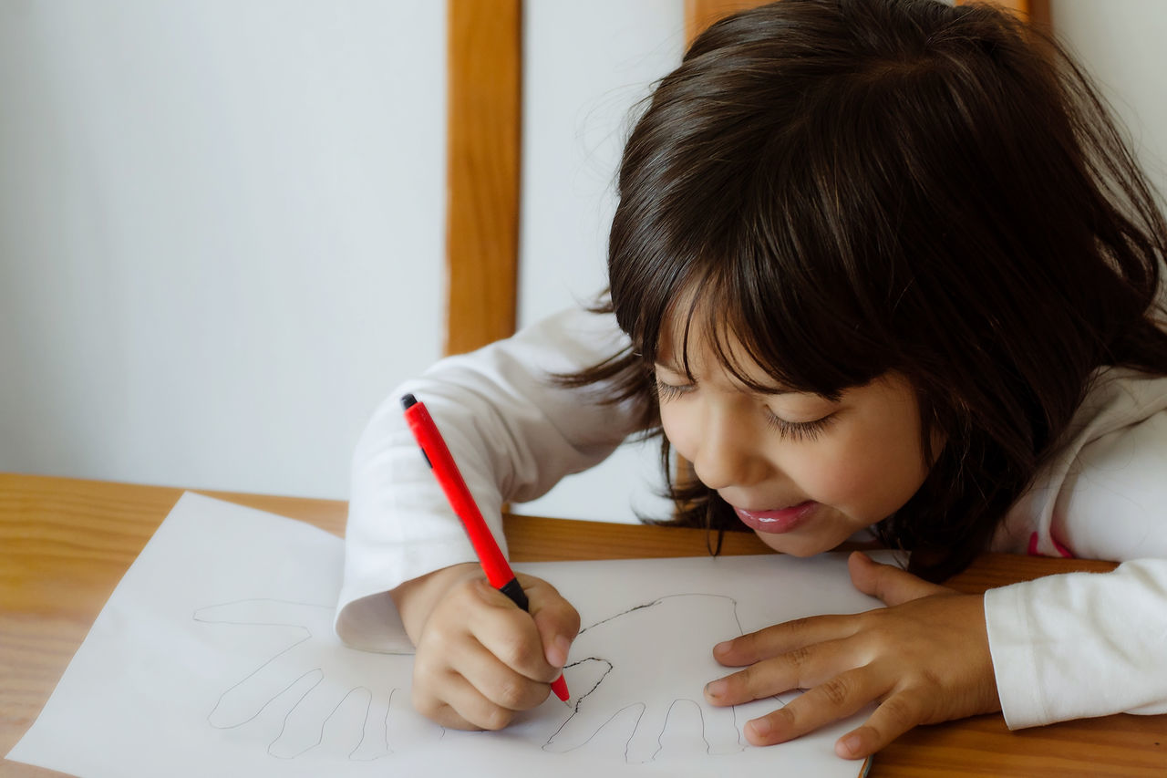 5 years girl doing educational exercises on a blank white paper Child Childhood Close-up Concentration Day Education Elementary Age Girls Headshot Holding Home Interior Indoors  Learning Looking Down One Person Paper People Real People Table Writing