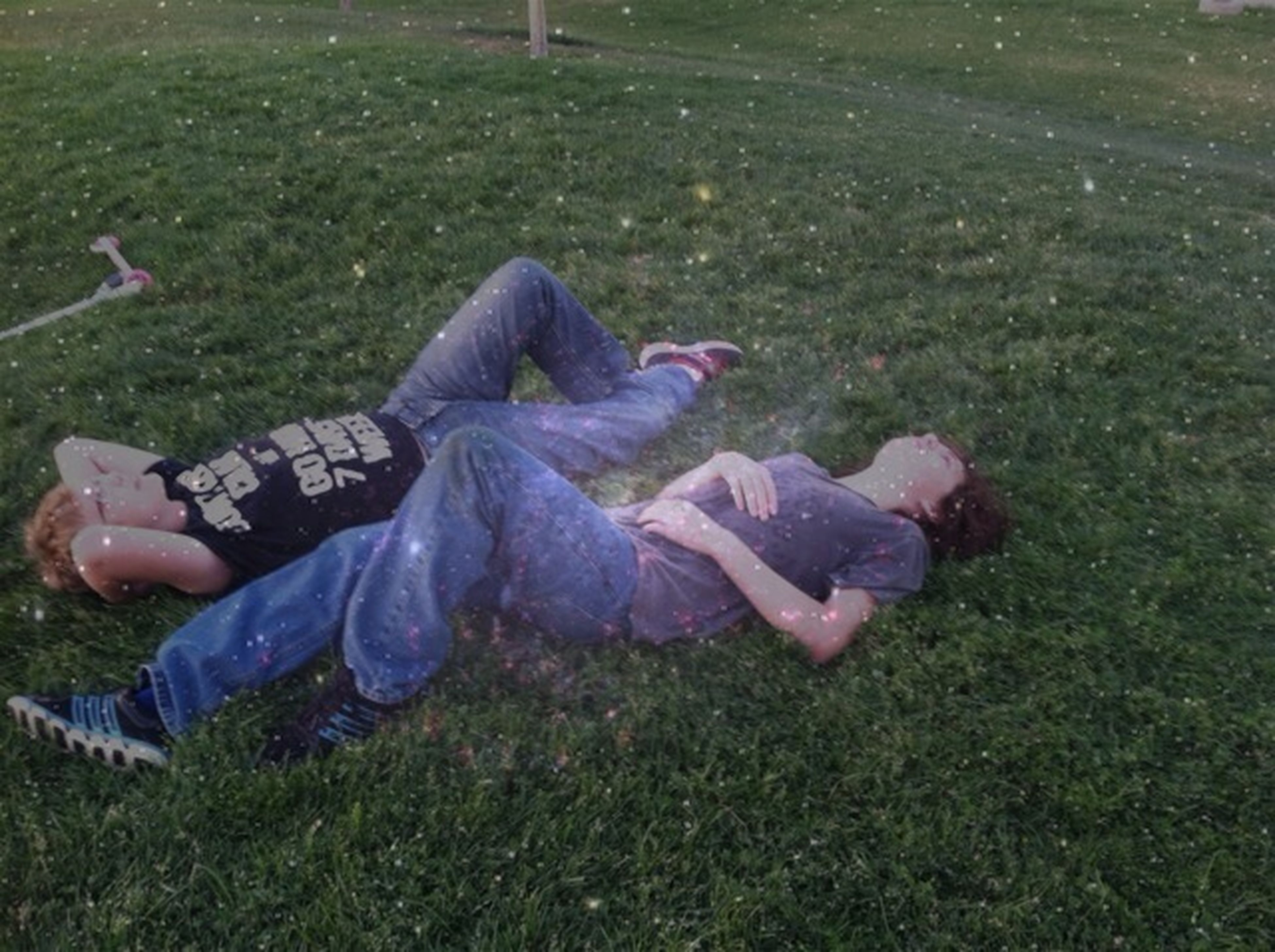 grass, field, grassy, lifestyles, leisure activity, sitting, casual clothing, green color, relaxation, men, lying down, full length, person, togetherness, day, childhood, outdoors