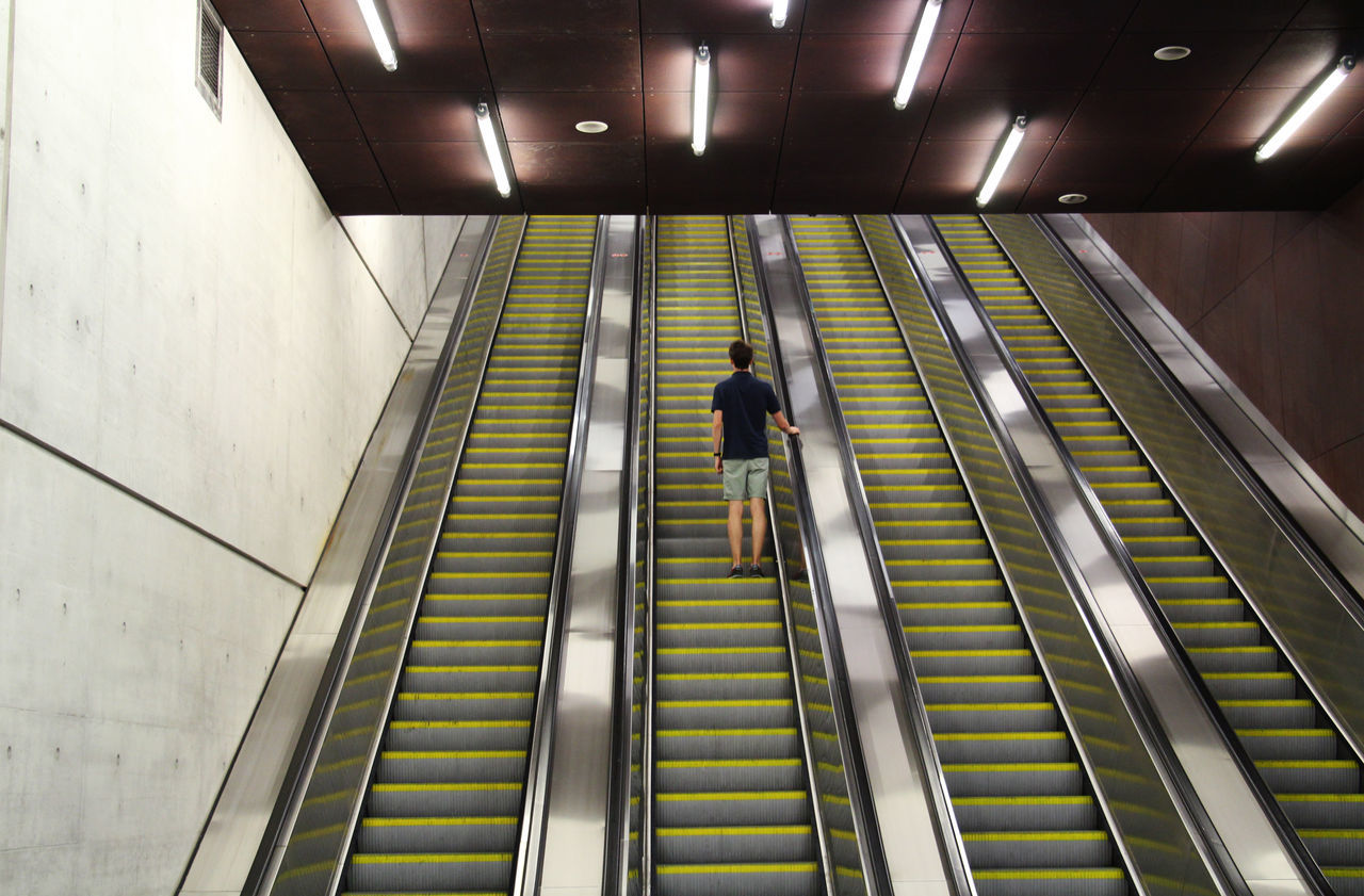 """""""Late night under ground"""" Alone Built Structure City Life Distant Escalator Geometric Shapes Indoors  Low Angle View Men Modern Motion Moving Up Rear View Stairs Steps Steps And Staircases Subway Underground Walking"""
