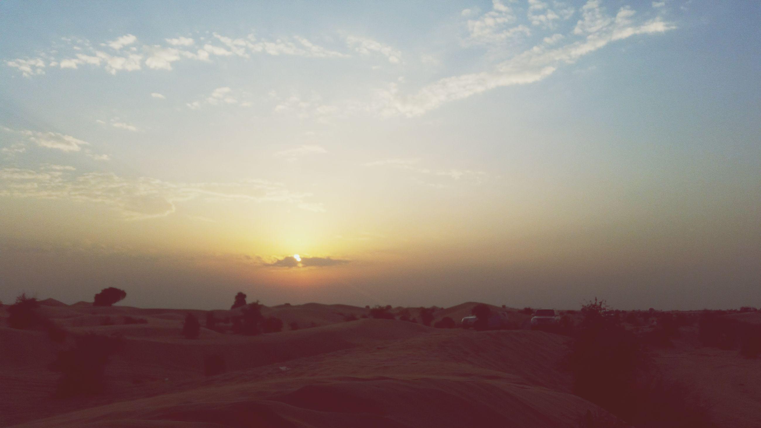 sunset, sky, tranquil scene, sun, landscape, scenics, tranquility, beauty in nature, sunlight, nature, cloud - sky, sunbeam, idyllic, horizon over land, non-urban scene, remote, lens flare, cloud, outdoors