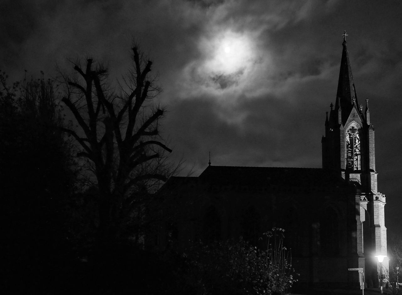 building exterior, architecture, built structure, religion, spirituality, night, place of worship, sky, outdoors, no people, low angle view, silhouette, illuminated, tree, bell tower, nature