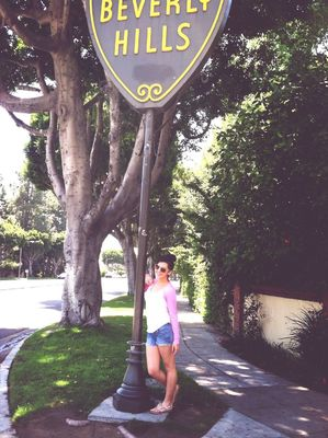 on the road at Beverly Hills Sign by Dalia Flores
