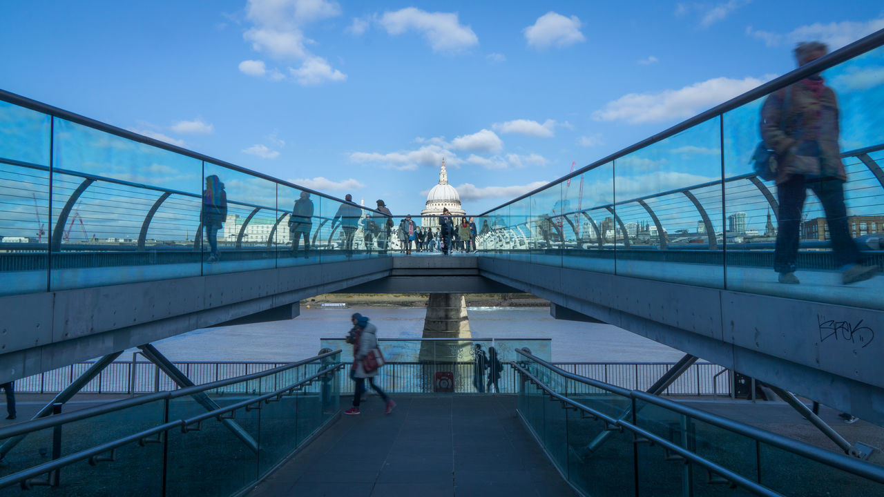 railing, built structure, bridge - man made structure, architecture, real people, walking, connection, sky, men, day, transportation, cloud - sky, women, leisure activity, lifestyles, travel destinations, outdoors, large group of people, full length, water, nature, people