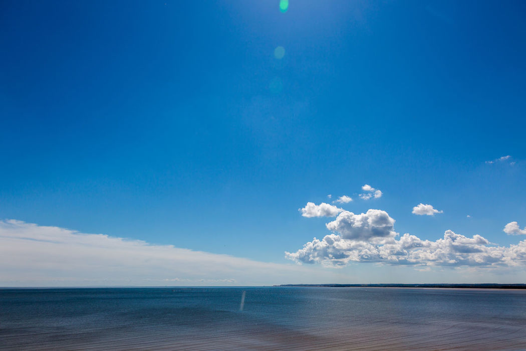 Sea low horizon in sunny day. Sky with two types of clouds Beach Beauty In Nature Bln Blue Calm Cloud - Sky Coastal Feature Day Horizon Horizon Over Water Landscape Low Horizon Nature No People Outdoors Quite Sand Scenics Sea Sky Summer Travel Vacations Water Wave