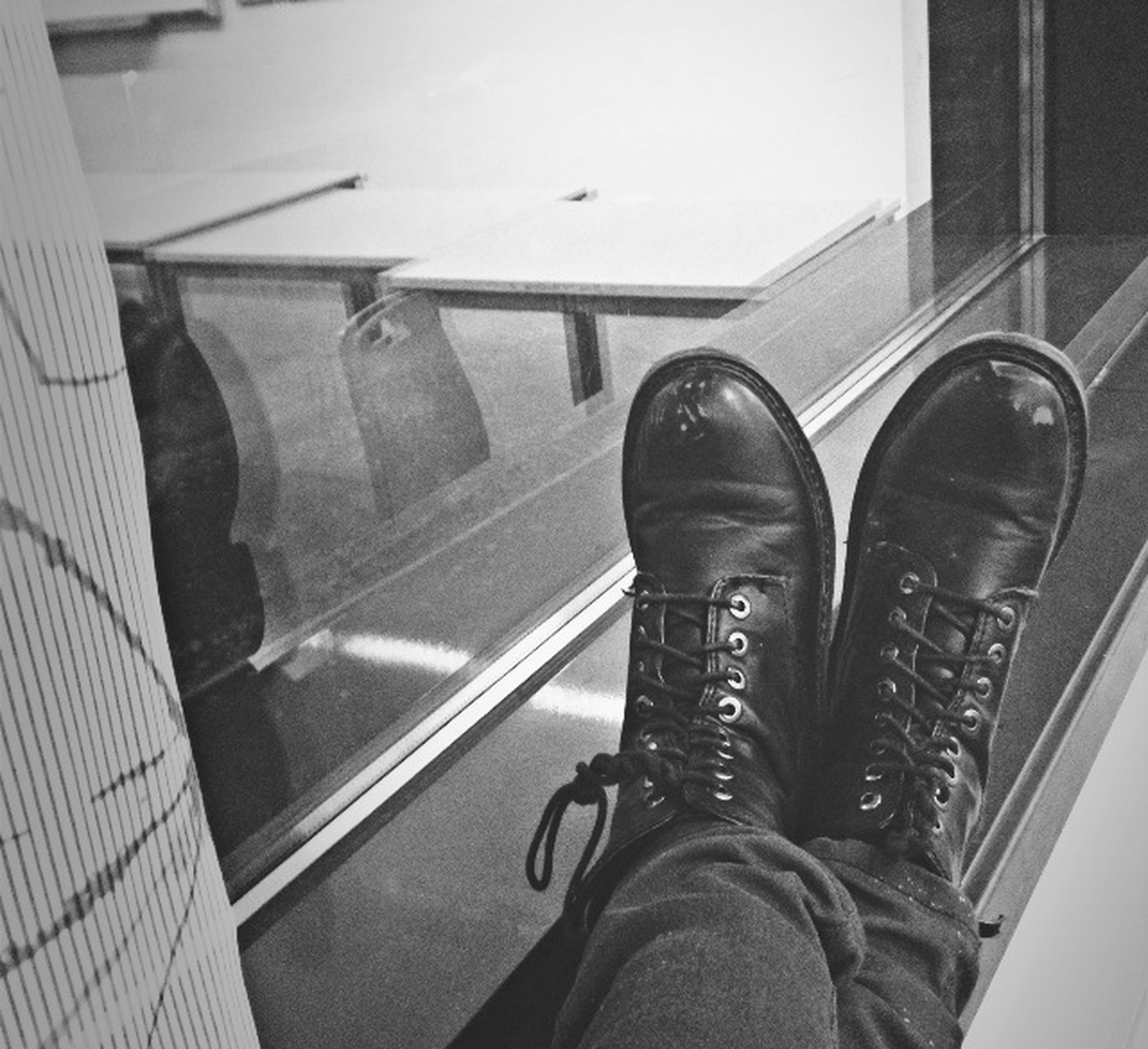 indoors, personal perspective, low section, person, shoe, part of, men, high angle view, lifestyles, footwear, architecture, unrecognizable person, human foot, glass - material, built structure, modern, standing