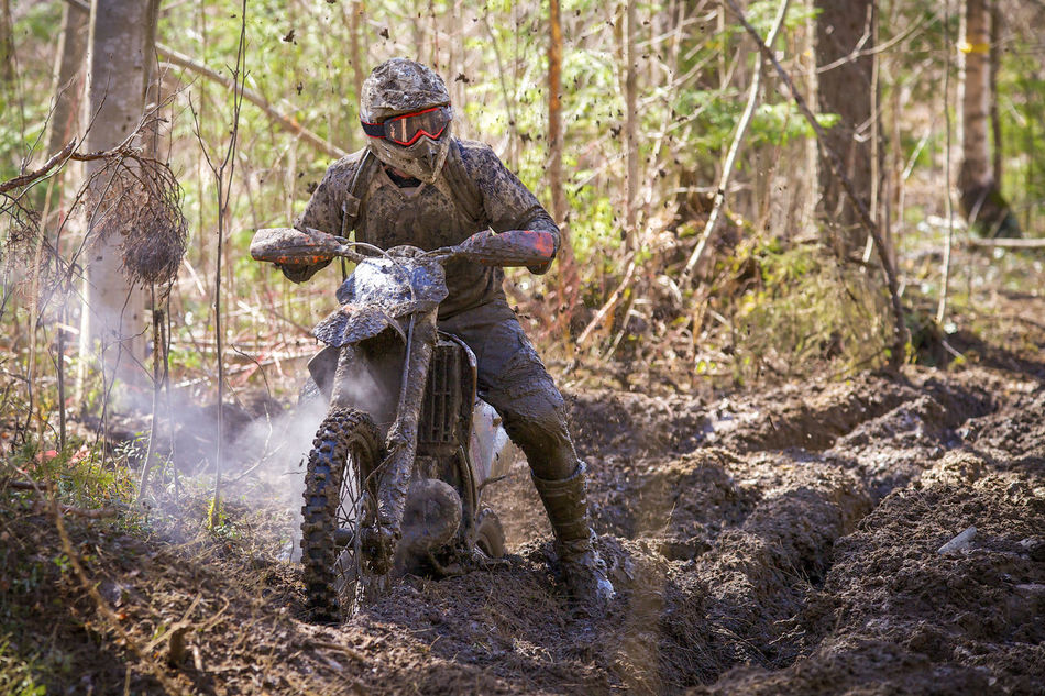 Motocross racer on wet and muddy terrain. Act Adrenaline Junkie Bike Cross-country Dirt Bike Dirty Enduro Racing Extreme Extreme Sports Fun Motion Motocross Motocross Race Motor Sport Motorbike Motorcycle Multi Colored Off-Road Offroad Outdoors Power Rider RISK Speed Trail