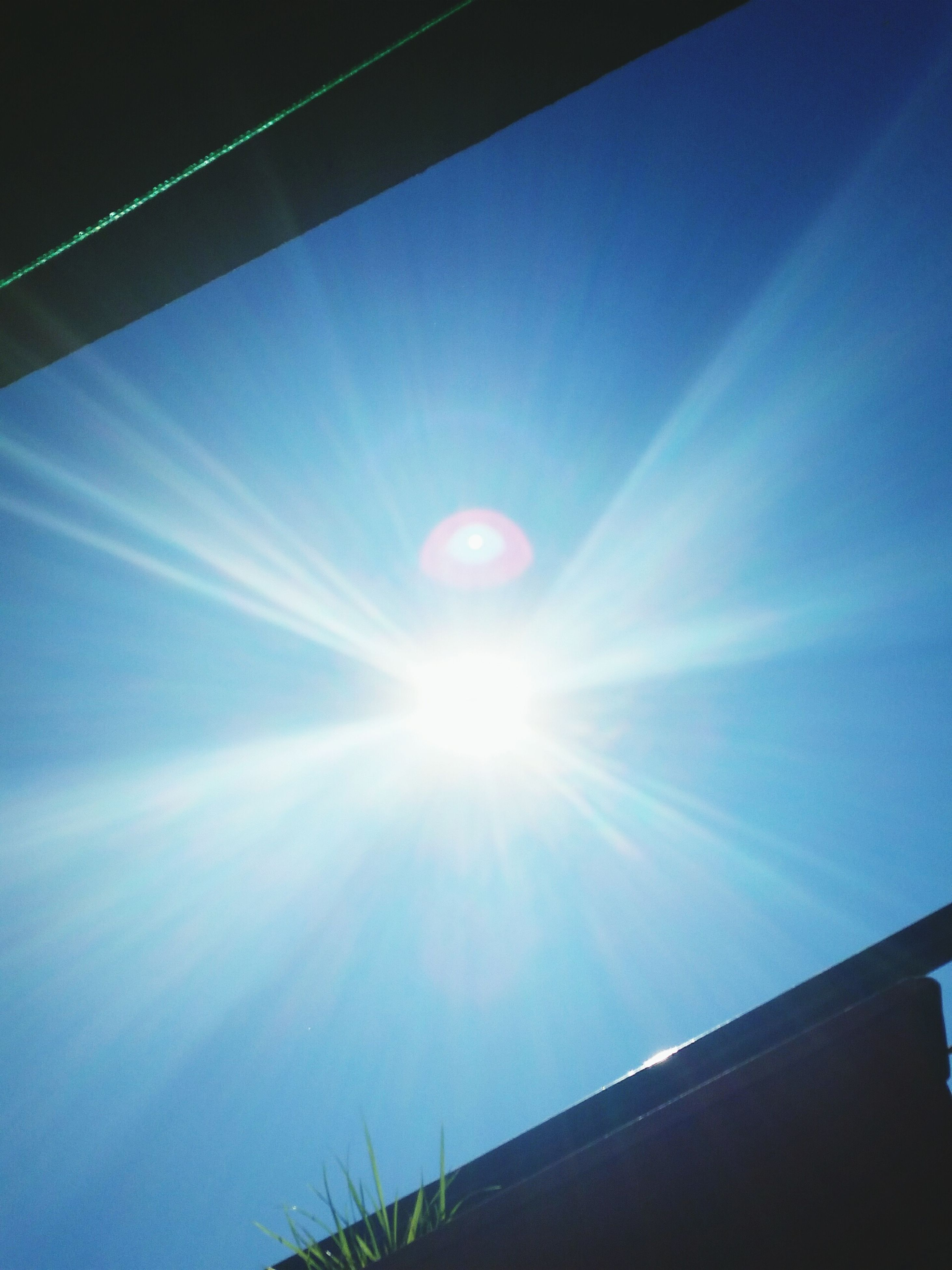 sun, low angle view, sunbeam, lens flare, sunlight, blue, sky, bright, sunny, vapor trail, nature, day, beauty in nature, outdoors, built structure, no people, tranquility, clear sky, architecture, part of