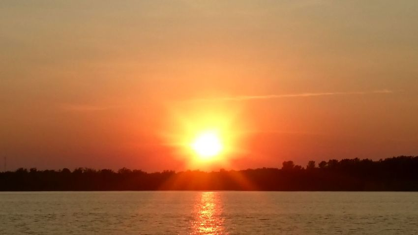 Sunset over Lake Champlain in NY. Sunset Orange Color Nature Sunlight Dramatic Sky Lake Tranquil Scene Beauty In Nature