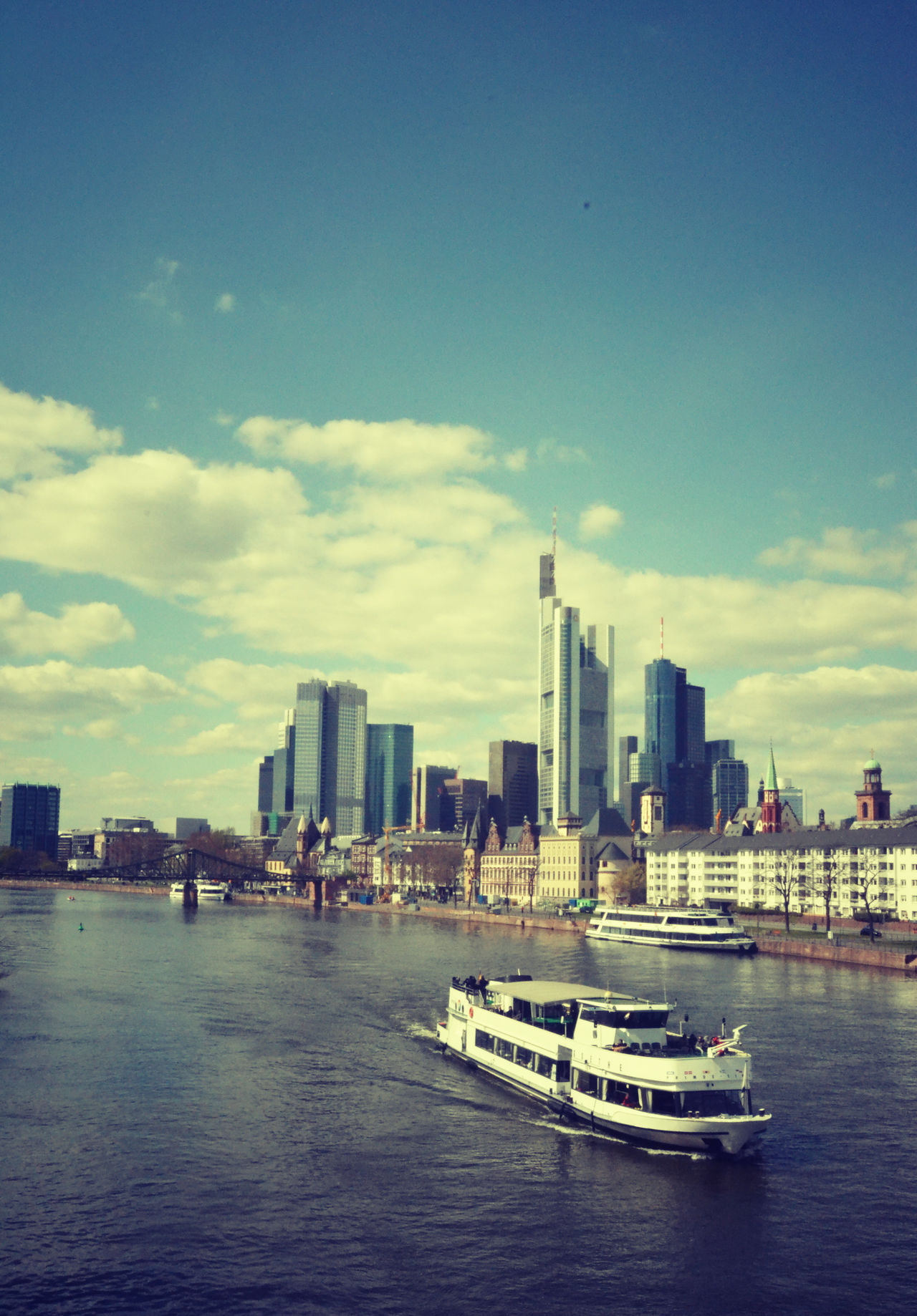 Architecture Built Structure City Cityscape Cloud Day Frankfurt Am Main Germany Main Mainhattan Mode Of Transport Modern No People Outdoors Retrostyle River Sky Sky And Clouds Skyline Skyscraper Tourboat Transportation Urban Skyline Water