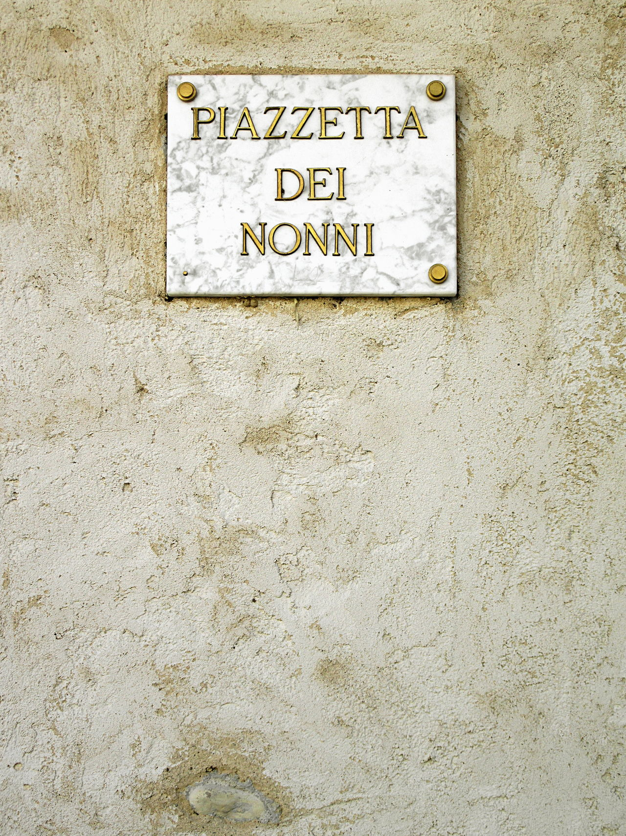 "Full frame shot of old weathered concrete wall with marble plaque with ""Piazzetta dei nonni"" sign (Italian for ""Grandparents' square"") Architecture ArchiTexture Close-up Communication Day Grandparents Marble No People Old Outdoors Place Plaque Sign Square Textures And Surfaces Wall Wall - Building Feature Weathered"