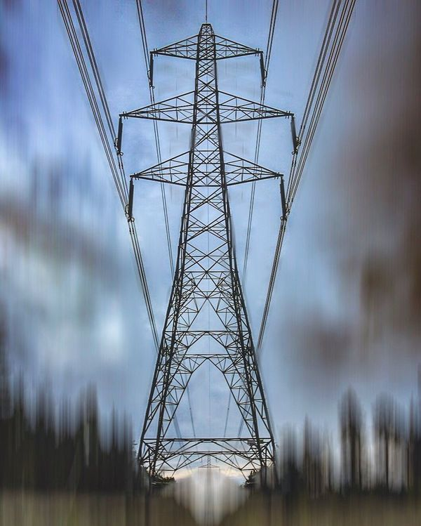 Electricity Pylon Electricity  Cable Connection Fuel And Power Generation Power Supply Grid Symmetry No People Below Steel Sky Girder Day Technology Global Communications Outdoors blur