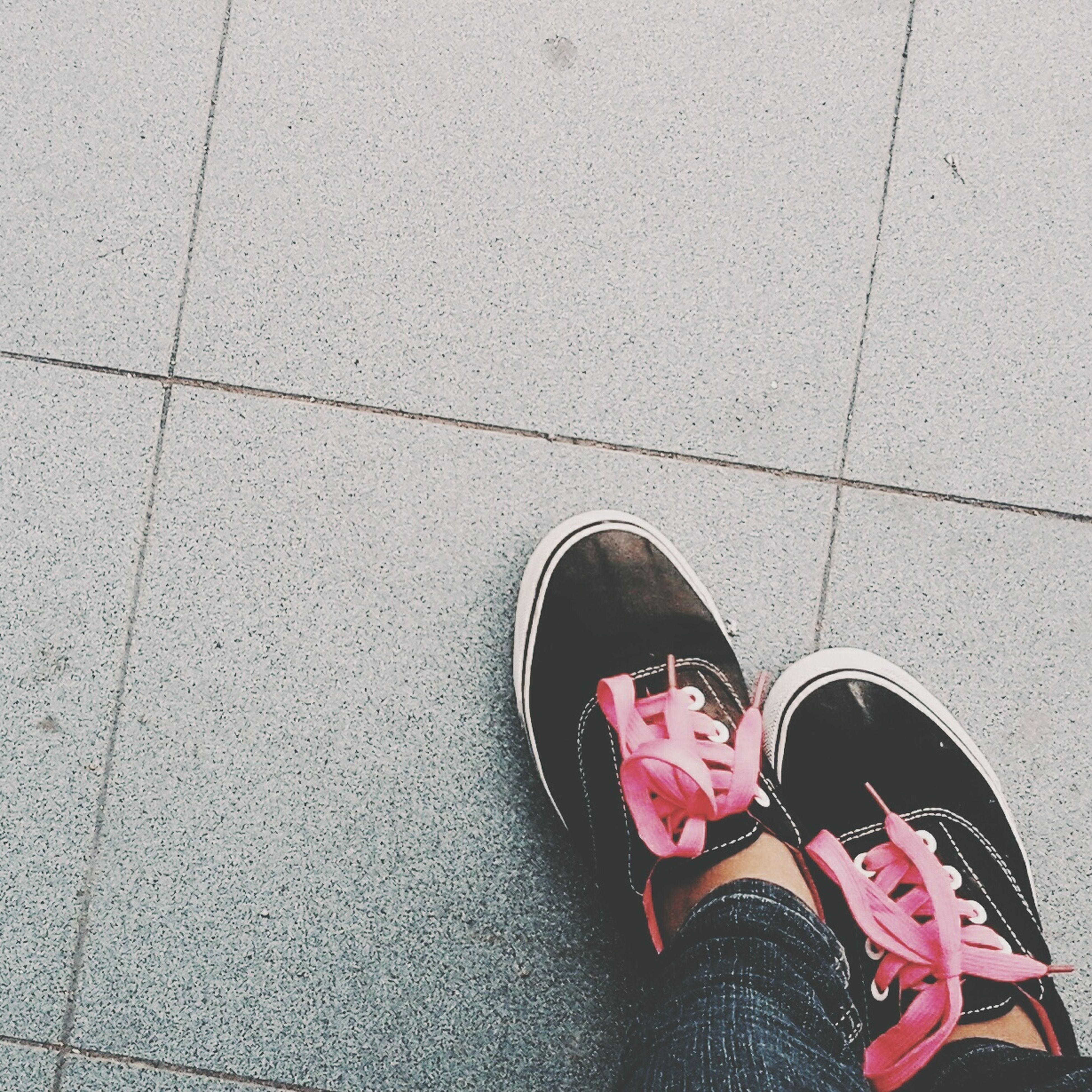 shoe, low section, person, high angle view, footwear, street, personal perspective, standing, directly above, human foot, cobblestone, paving stone, tiled floor, pair, flooring, footpath, canvas shoe