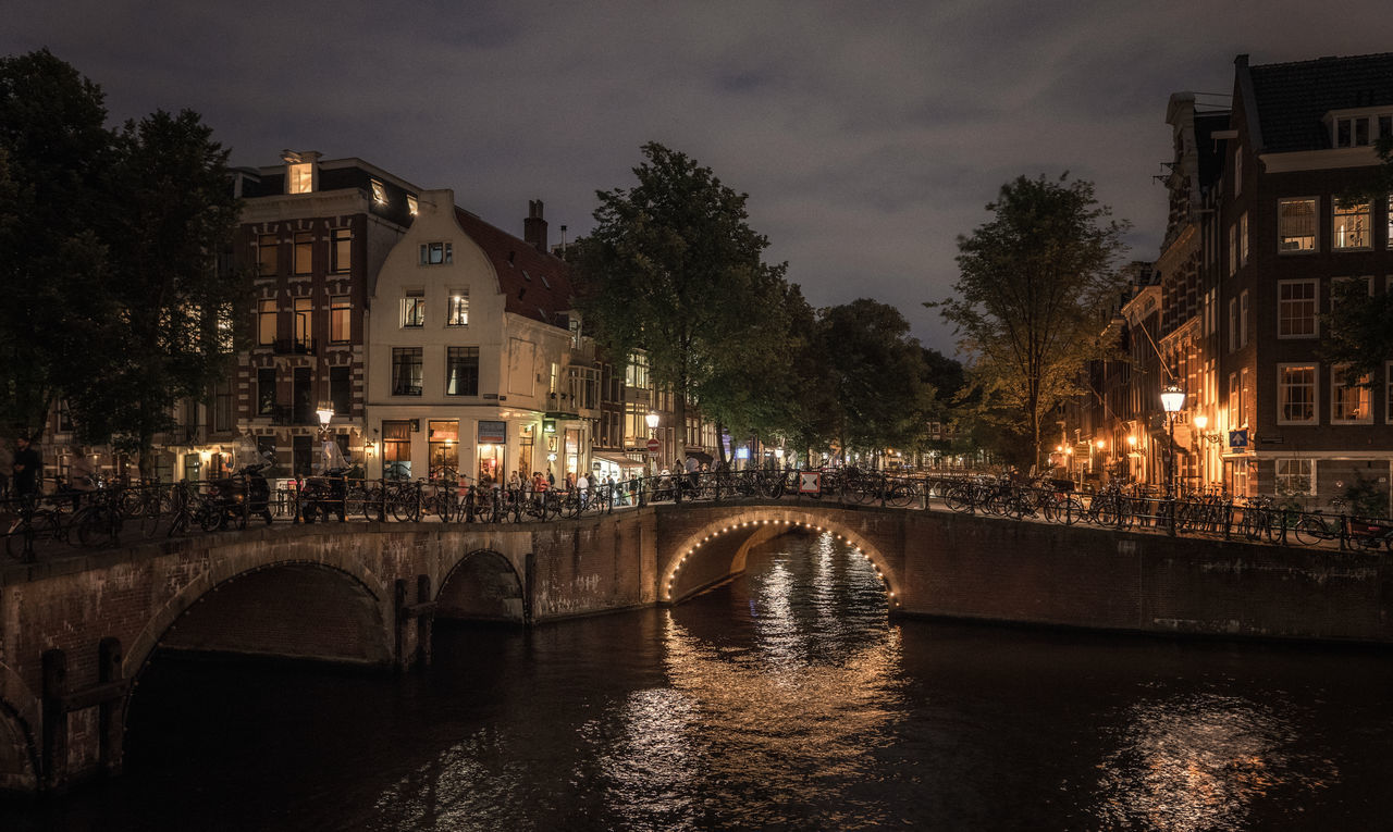 Night capture around the canals, Amsterdam. It's Friday night and busy at the bars Amsterdam Arch Bridge Architecture Bridge - Man Made Structure Building Building Exterior Canal Houses Canalampliado City City Life Full Frame Historical Mood Captures Mood Lighting  Night Street Water
