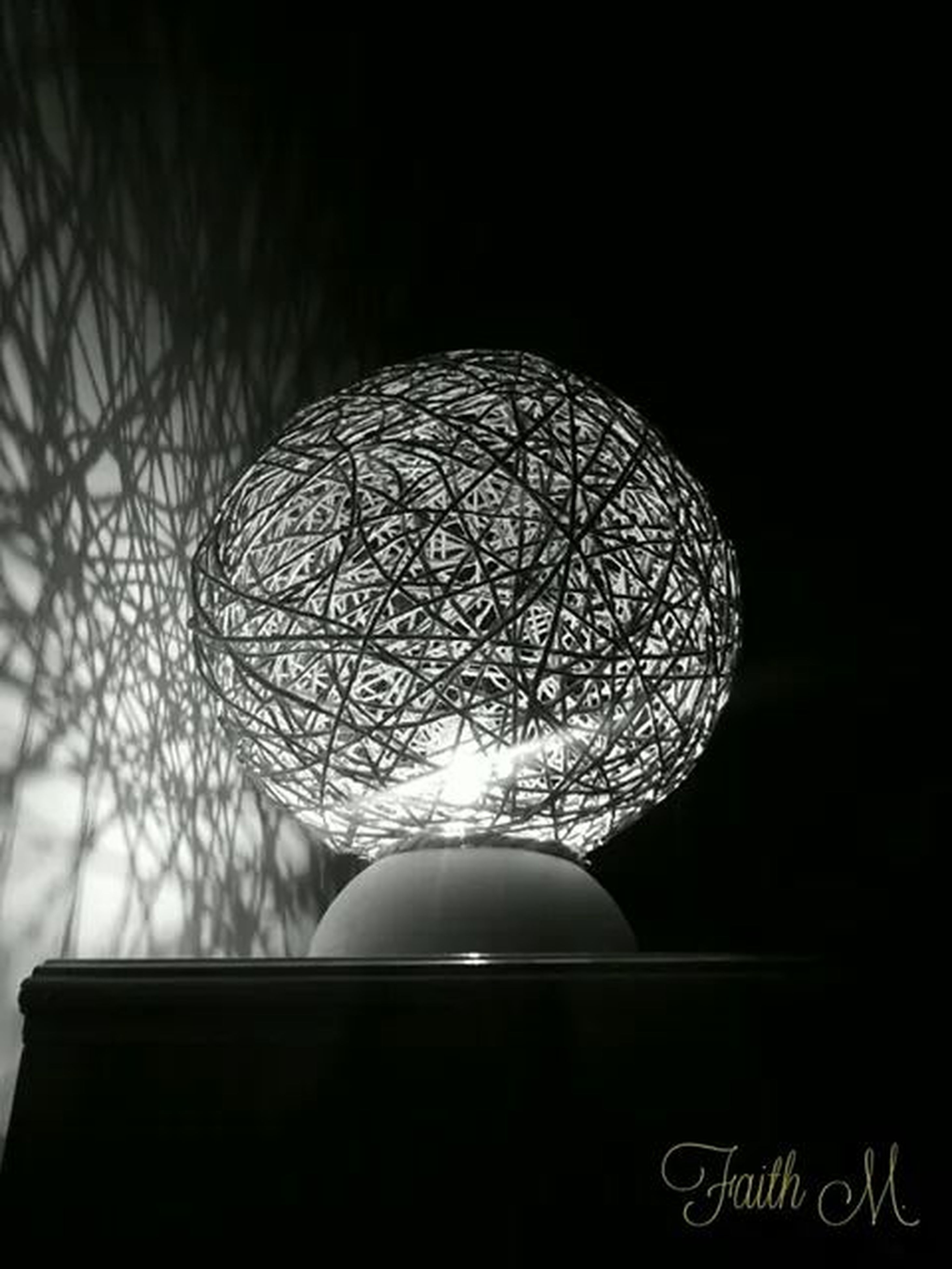 indoors, illuminated, low angle view, lighting equipment, circle, close-up, decoration, electric lamp, design, ceiling, pattern, electricity, night, hanging, geometric shape, sphere, glass - material, no people, dark, electric light