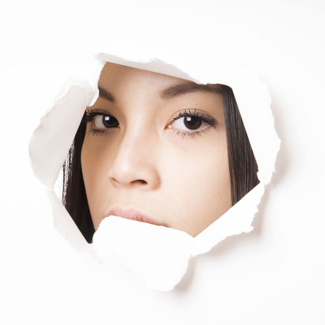 Asian  Close-up Face Girl Hole Looking Paper Peeking Peeping People Person Portrait Real People Torn Vietnamese White Background Woman Young Woman