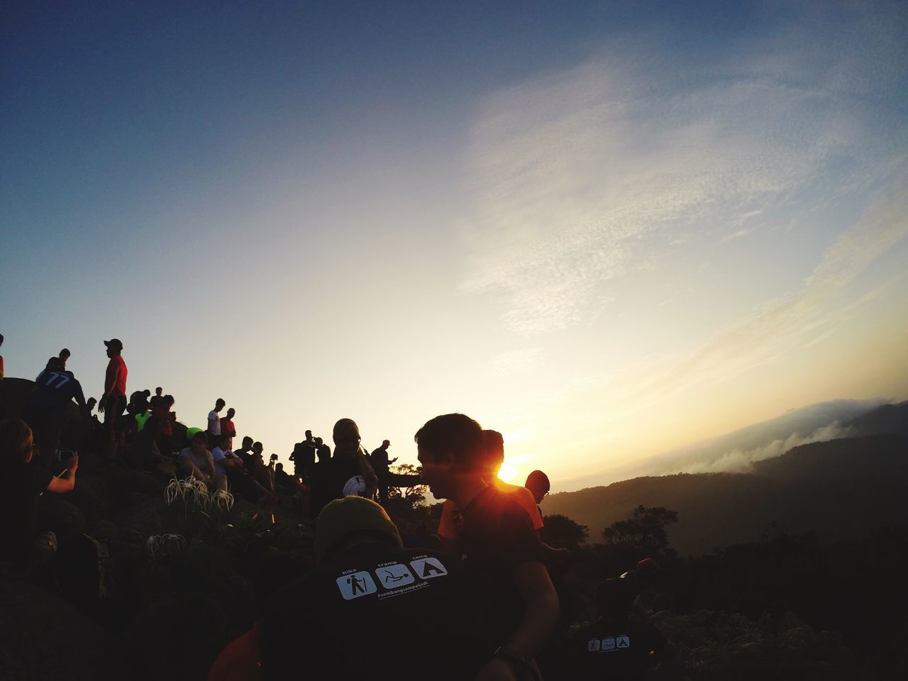 sunset, real people, men, sky, leisure activity, large group of people, togetherness, outdoors, women, lifestyles, nature, crowd, day, adult, people