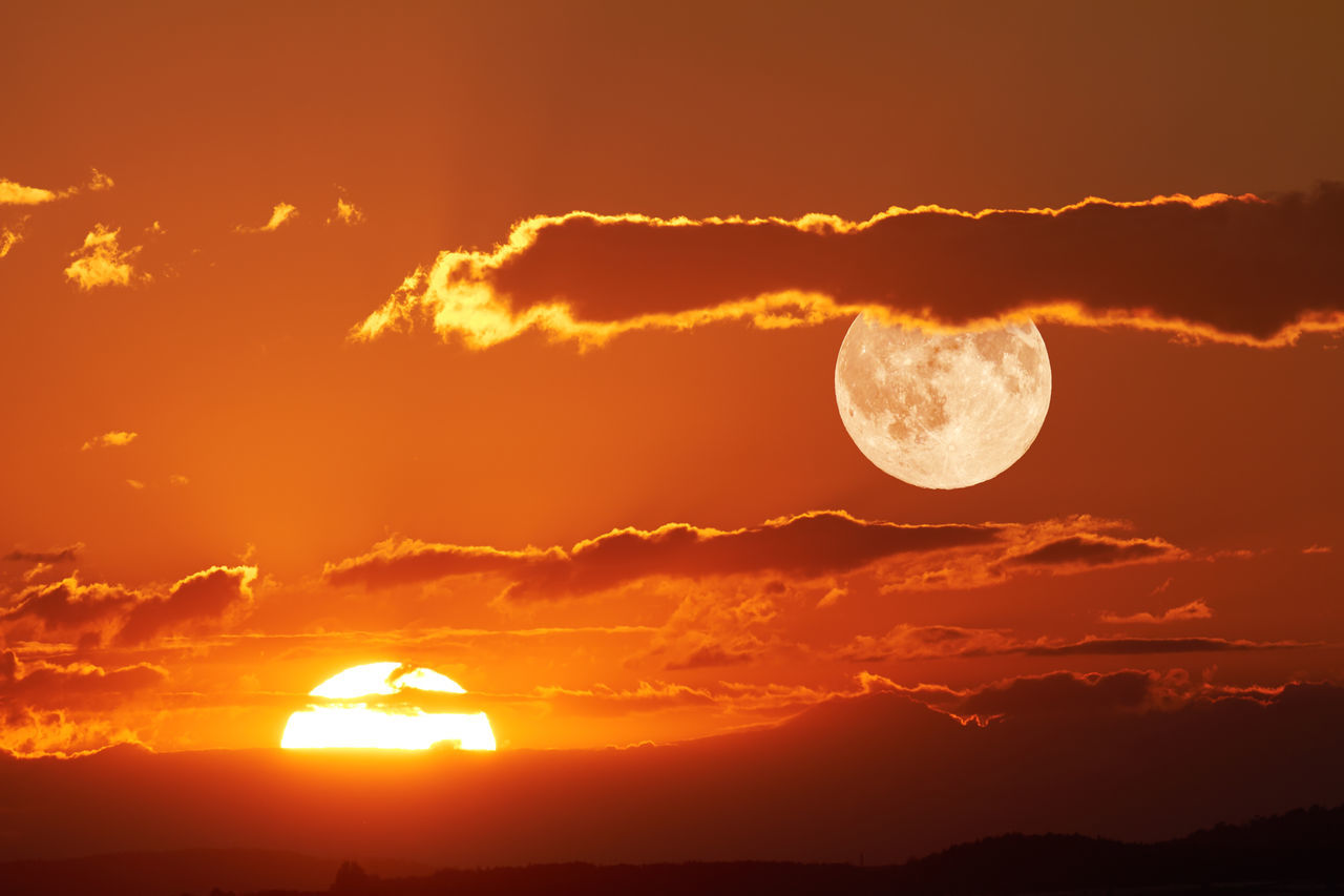 Sun and Moon Atmosphere Atmospheric Mood Beauty In Nature Cloud Cloud - Sky Cloudscape Cloudy Dramatic Sky Glowing Light Majestic Moody Sky Orange Color Outdoors Overcast Silhouette Sky Storm Cloud Sunset