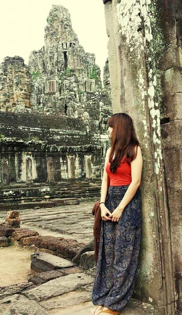 old ruin, architecture, ancient, ancient civilization, built structure, archaeology, spirituality, religion, history, travel destinations, real people, travel, day, leisure activity, building exterior, women, place of worship, lifestyles, young women, one person, young adult, smiling, outdoors, tree, adult, people