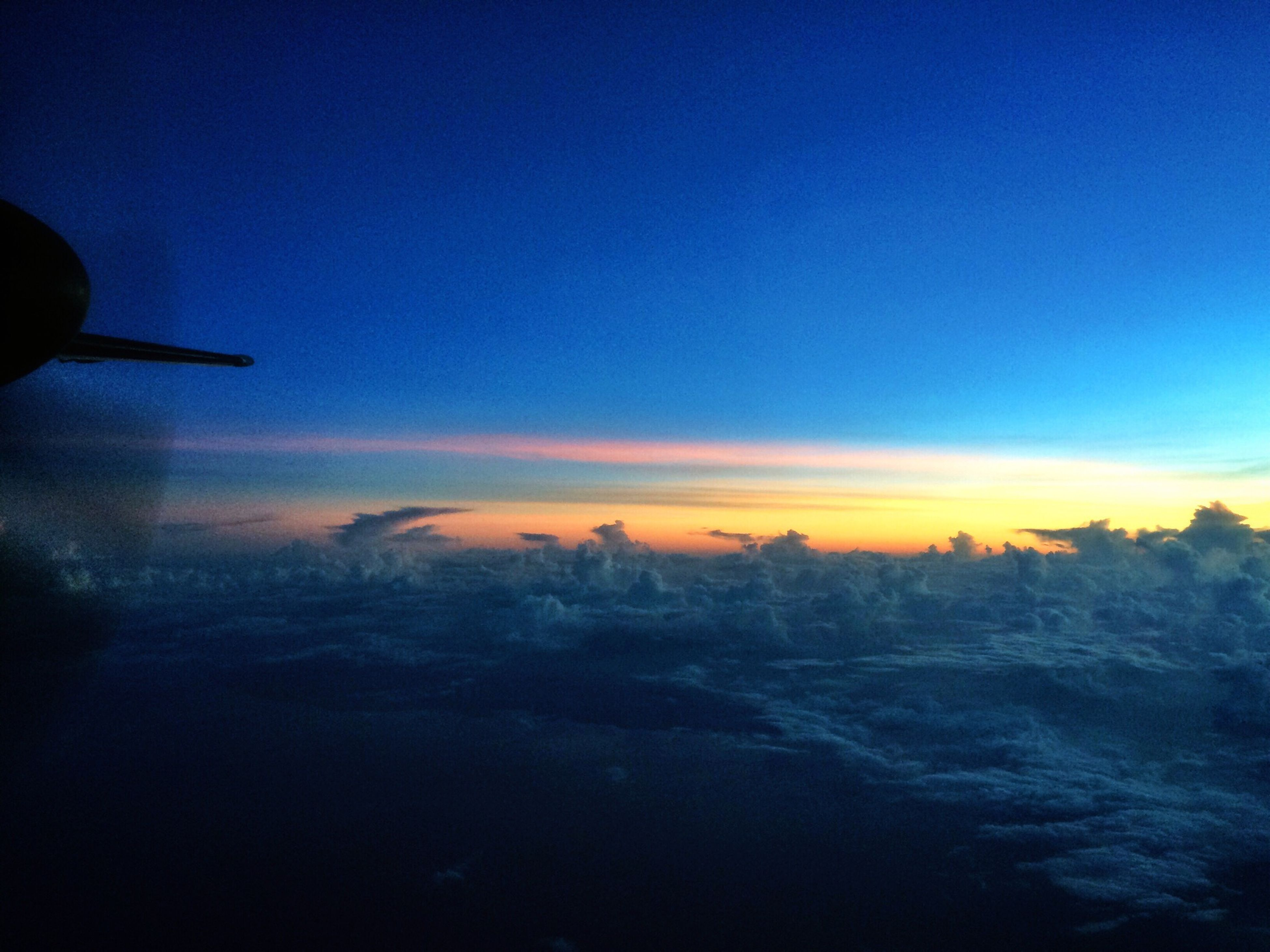 sunset, scenics, beauty in nature, blue, sky, tranquil scene, copy space, tranquility, nature, landscape, dusk, orange color, idyllic, airplane, cloud - sky, transportation, weather, air vehicle, mountain, winter