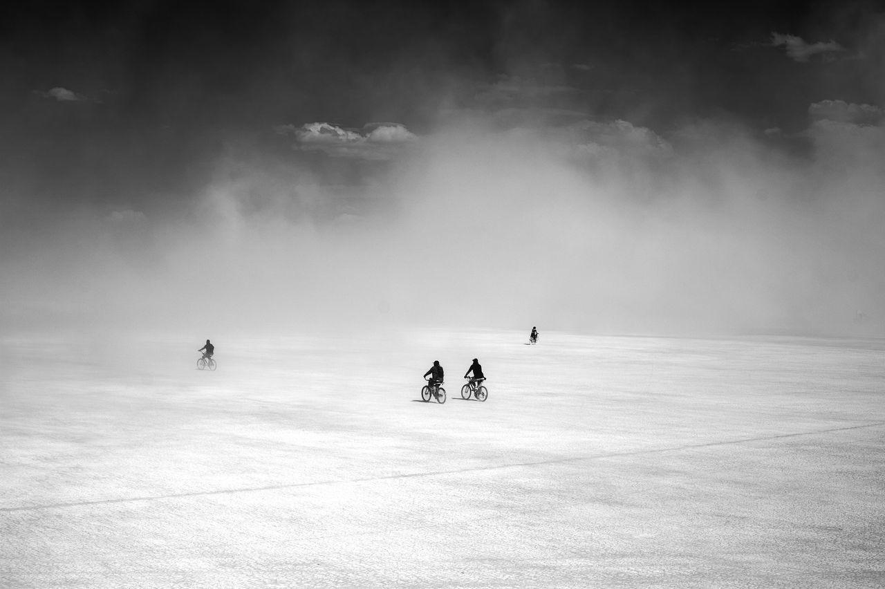 People Biking In The Desert